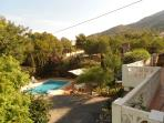 View of the garden and pool area with the 'Serra Gelada' natural park at the back