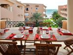 Quinta del Sol condo Mayan Waters - outdoor dining al fresco on covered terrace