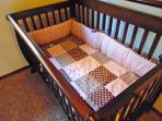 Sturdy crib with bedding for the child