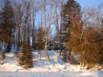 Winter view of cottage from the lake