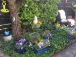 Mini garden in side patio by summer room.