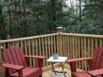 cozy corner of the deck with surrounding pines
