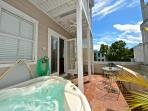 Private deck featuring a hot tub, for your relaxation and enjoyment