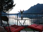 Romantic sunset on the private balcony with spectacular Lake Como views