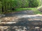 Large flat parking area between cabin and fire pit area