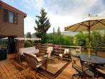 Outdoor living/dining area with abundant views