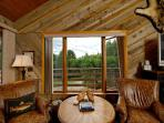 Great room seating area with view of Aspen Mountain