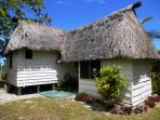 Back side of Coco Cottage shows the additional outdoor spring water shower w/ covered clothesline