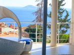 Balcony and daybed off the master bedroom with stunning sea views.
