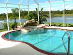 our pool and spa overlooking lake and preserve