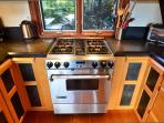 Nice kitchen stove with view out to front rock steps