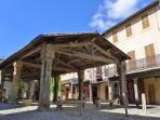 Step out of the house onto the medieval market place .