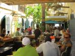 ...an open air bar in the elegant Palm Passage...