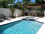 Pool with covered dining area, ideal for BBQ s