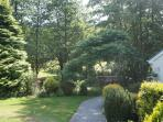 Pathway at the rear of lodge cottage leading to the stream