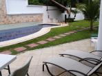 Large pool is just steps from your spacious and well furnished patio