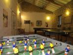 The games room at Barrusclet has table football, pool, darts, and table tennis.