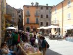 Weekend farmers market in Montone