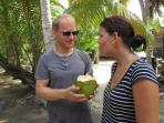 enjoying the first fresh coconut water