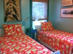 room in cottage with twin beds