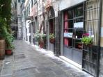 Access to the building and the windows of the restaurant Ombre Rosse