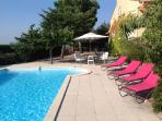 pool area and terrace in large private garden
