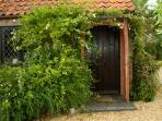 Riverside Cottage side door tp garden