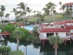 View of Pointe Santo clubhouse, pool, lagoon and Gulf