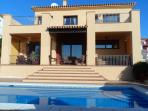 Rear of the villa and steps down to pool