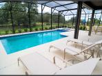 Large deck with heated pool and hot tub