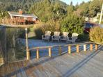 Large dual level deck with ocean and mountain views and patio chairs to enjoy the view from.