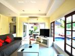 open plan lounge ,patio doors opening to pool and chill out area