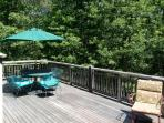 large deck overlooking acres of private wooded conservation land