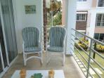 Balcony with two comfy padded rocker chairs