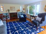 Living Room with door that opens to front yard that offers access to pond - 5 Ocean Street South Harwich Cape Cod New...