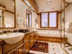 The private bathroom to Master Bedroom #1 features a double vanity, a jetted tub, and a separate walk-in steam shower.