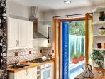 Modern and white, the kitchen offers everything you will need