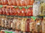 Rows of pickled veg - everything from stuffed tomatoes to grilled aubergine - look at those colours!