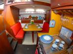 The cheerful Dinette and Galley is equipped with electric stove, full size fridge, coffee&tea maker.