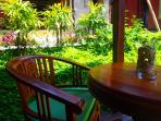 Balcony surrounded lush gardens