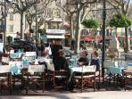Eating outside in Vence's main square in  winter