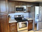 High quality stainless steel appliances in the kitchen.