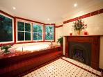 Double spa bath with mahogany fireplace