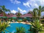The stylish bungalows are carefully placed around our large swimming pool in a tropical garden.