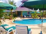 Our pool deck. Relax in the sun next to our big swimming pool - you have earned it!