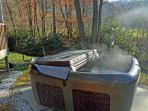 Hot tub above the creek just waiting for you