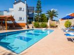 The pool area is equipped with sun beds and parasols!