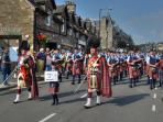 Piped bands in Pitlochry high street.