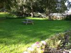 Back garden with picnic table.