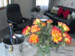 A bunch of fresh flowers and a bottle of local farm cider always offered on arrival